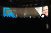 Michael Dell - CEO, Dell embraces Joe Tucci - CEO, EMC Corporation on stage during EMC World 2016