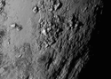 "One of the first images near Pluto's equator reveals a range of ""youthful"" mountains ranging about 100 million years old and about 11,000 feet high."