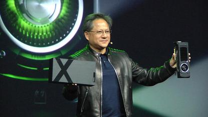 Nvidia CEO Jen Hsun Huang unveils the company's Titan X graphics card at the GTC 2015 conference in San Jose on March 17, 2015