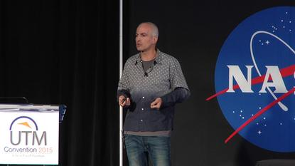 Gur Kimchi, co-founder of Amazon Prime Air, speaks at a conference at NASA Ames on July 28, 2015.