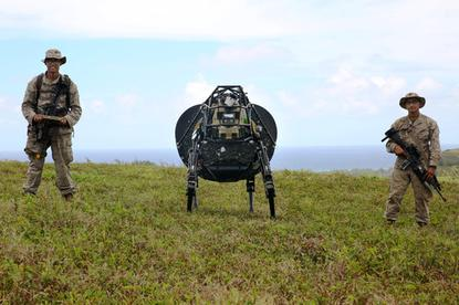 Google's LS-3 robot is put through its paces by Lance Cpl. Brandon Dieckmann, (left) and Pfc. Huberth Duarte of India Company, 3rd Battalion, 3rd Marine Regiment, U.S. Marines, at Kahuku Training Area on Oahu, Hawaii, July 12, 2014.