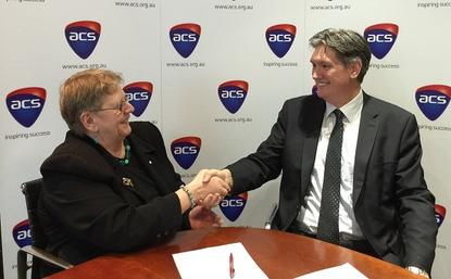 ACS president Brenda Aynsley (left) congratulates COO Andrew Johnson on securing the CEO role. Photo credit: ACS.