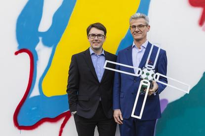 Myriota CEO and co-founder Dr Alex Grant and Optus Business managing director Chris Mitchell.
