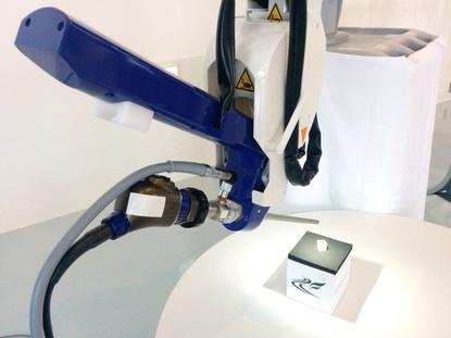The Emaro endoscope surgical robot is shown off at Tokyo Institute of Technology on July 31, 2015. The air-powered robot can hold endoscope cameras steady during surgery.