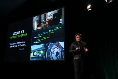 Nvidia CEO  Jen-Hsun Huang shows the Tegra X1 at CES