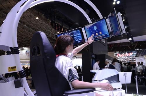 A model demonstrates a futuristic health pod developed by Sharp, on show at the Ceatec 2013 expo in Japan on October 1, 2013.