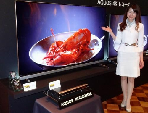 Sharp's Aquos 4K TU-UD1000 recorder and Aquos LC-70UD20 4K TV are shown off at a press event in Tokyo.