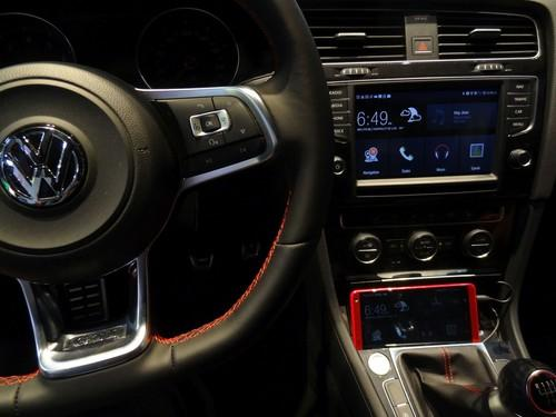 An HTC smartphone connected to a Volkswagen in-dash display shows off the capabilities of MirrorLink 1.1 at Mobile World Congress