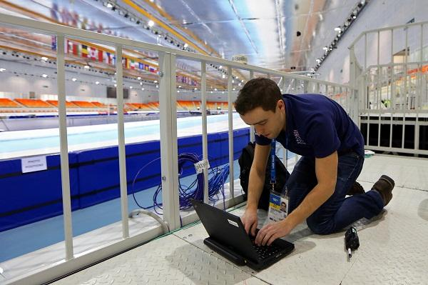 Clement Caplain from Getty Image's French office tests the network in the Adler speed skating arena.