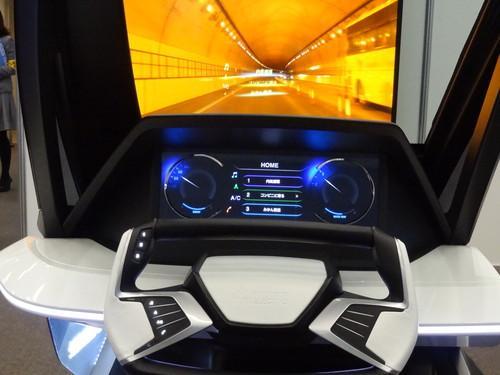 Mitsubishi Electric's Ultra-easy HMI prototype is a predictive agent that anticipates driver choices for onboard electronics such as navigation systems, displaying menu choices on a HUD.