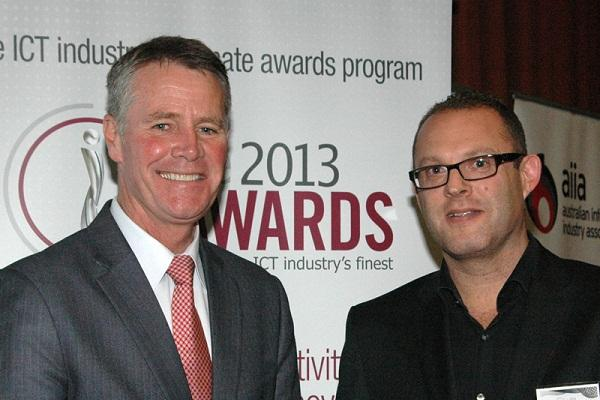 UXC Red Rock Consulting CEO Jonathan Rubinsztein (right) receives the ICT Professional of the Year award from NSW Deputy Premier Andrew Stoner.