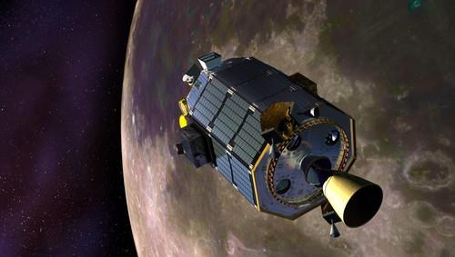 An artist's concept of NASA's Lunar Atmosphere and Dust Environment Explorer (LADEE) spacecraft orbiting the moon and preparing to fire its maneuvering thrusters to maintain a safe orbital altitude.