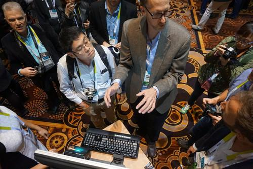 Brent Safer, an inventor who founded Motix, demonstrates his cursor control gesture technology at CES.
