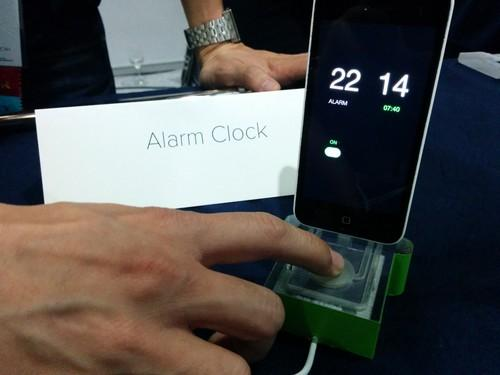 Acoustruments, developed by Disney and Carnegie Mellon University (CMU), are plastic add-ons that use ultrasound signals emitted from the speaker of a phone and picked up by its microphone. This example at CHI 2015 in Seoul controls an alarm clock app.