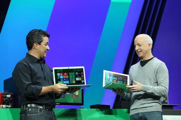 Steven Sinofsky, president of Windows and Windows Live, and Michael Angiulo, corporate vice president of Windows Planning, Hardware & PC Ecosystem, [[artnid:400762|demonstrate how Windows 8 works across a spectrum of devices|new]] during the keynote address at the BUILD conference in Anaheim, California.