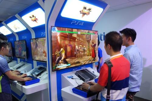 Chinese gamers play Street Fighter V at the Sony PlayStation booth at ChinaJoy.