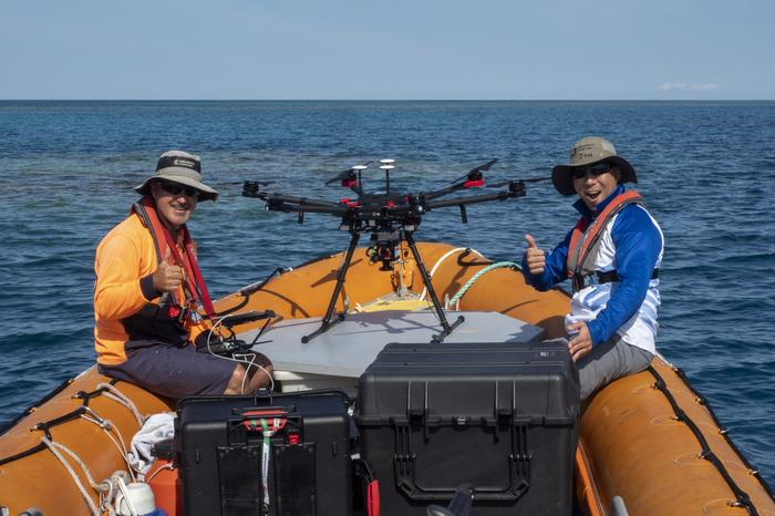 AIMS' marine technical officer Joe Gioffe and hyperspectral specialist Jonathan Kok with the drone