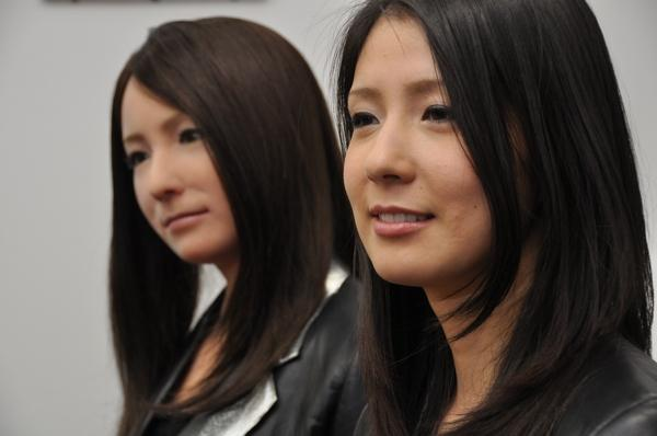 Geminoid F and her human counterpart. Credit: Osaka University